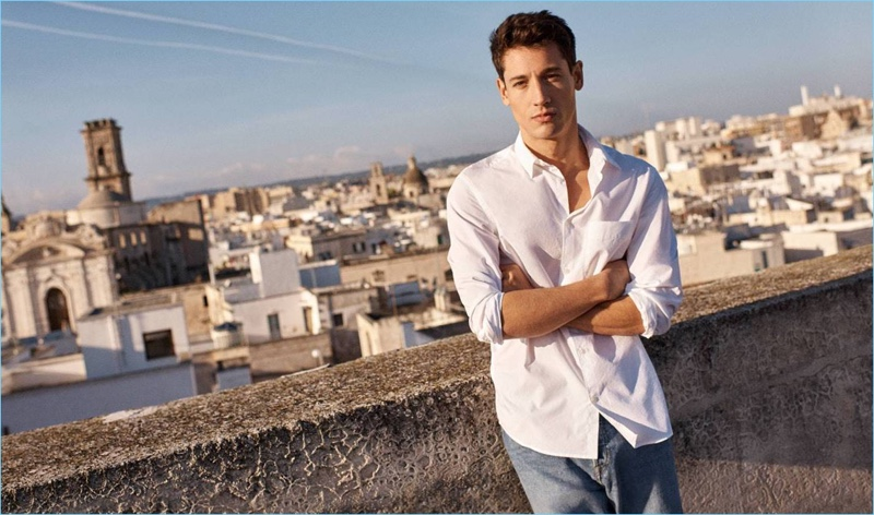 Nicolas Ripoll wears a white pima cotton shirt with relaxed denim jeans by H&M.