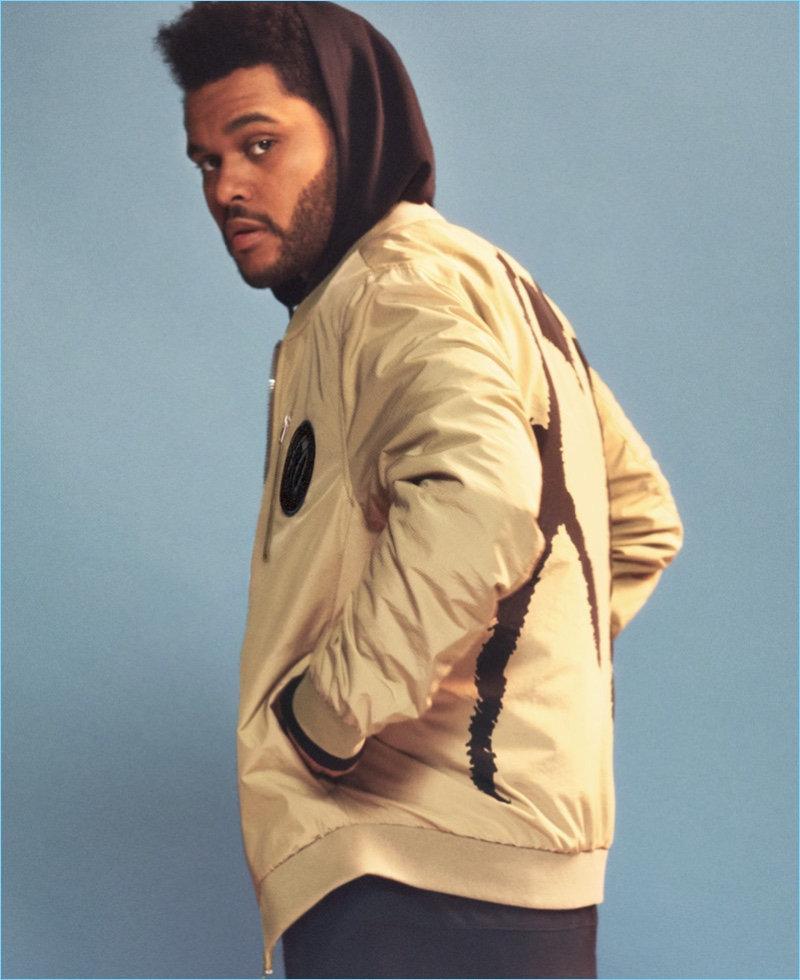 Singer The Weeknd sports a tan bomber jacket from H&M's Spring Icons.