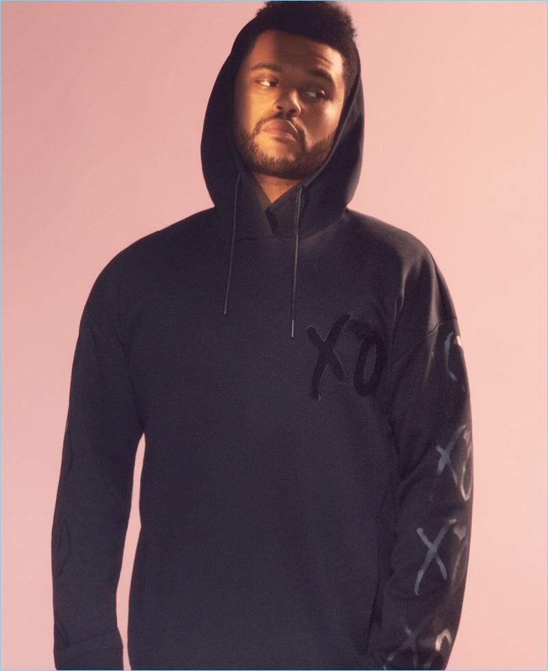 H&M's scuba fabric is back as The Weeknd sports a hooded sweatshirt.