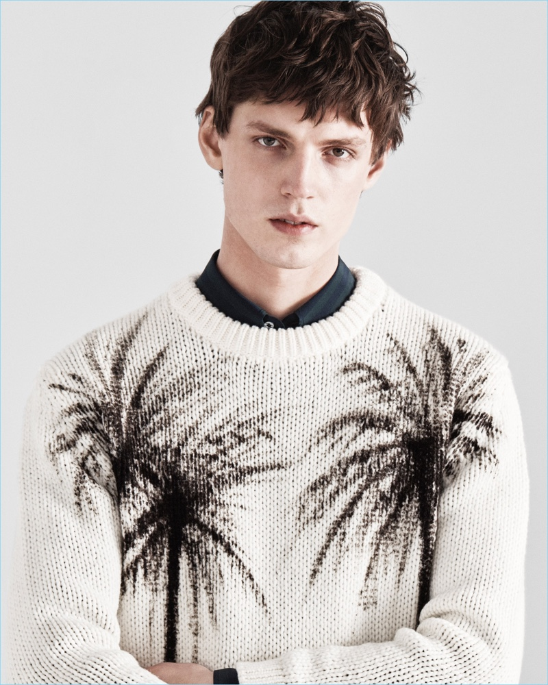 A crewneck sweater is dressed up with images of palm trees for Jeffrey Rüdes' fall-winter 2017 collection.