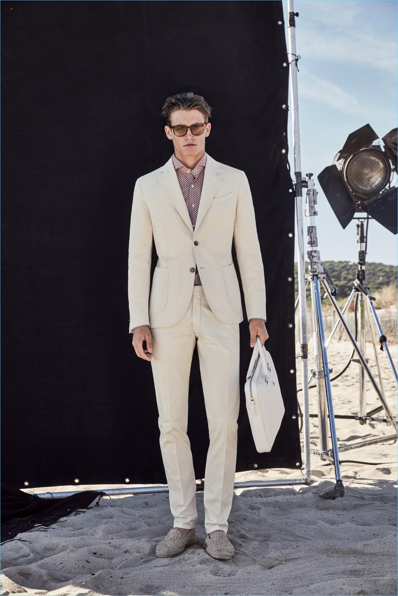 Neutral style reigns as Sascha Wolf wears a tan suiting number from L.B.M. 1911.
