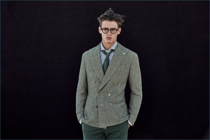 Wearing glasses, Sascha Wolf sports a dashing green suiting look from L.B.M. 1911.