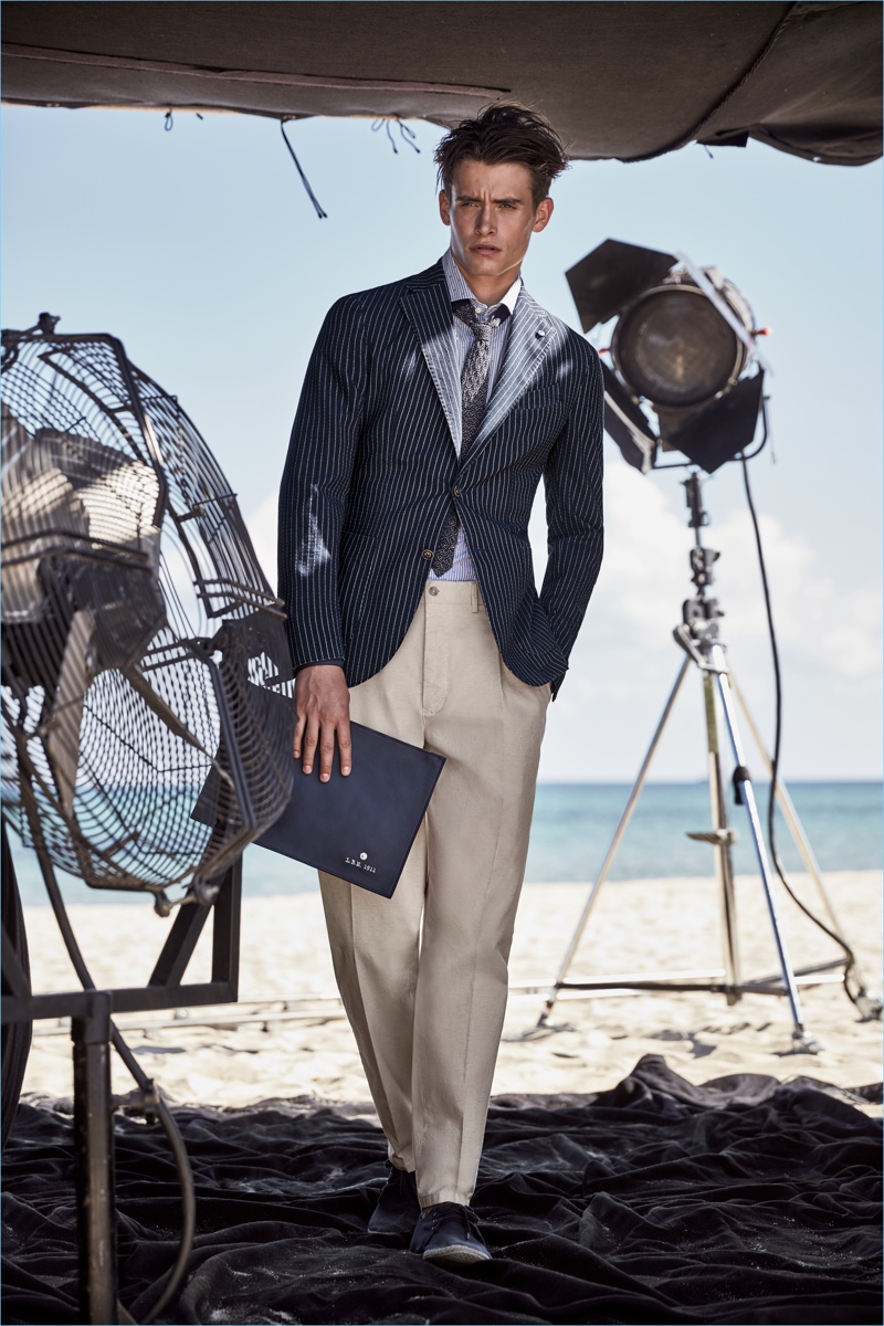 L.B.M. 1911 curates a sartorial season with must-haves such as a navy pinstripe blazer and khaki trousers.