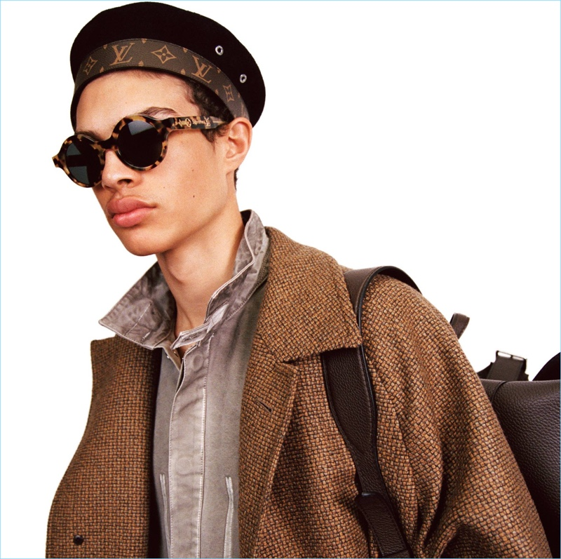 Louis Vuitton applies its famous leather monogram to a Parisian style beret  for fall-winter 0d4bc764fc7