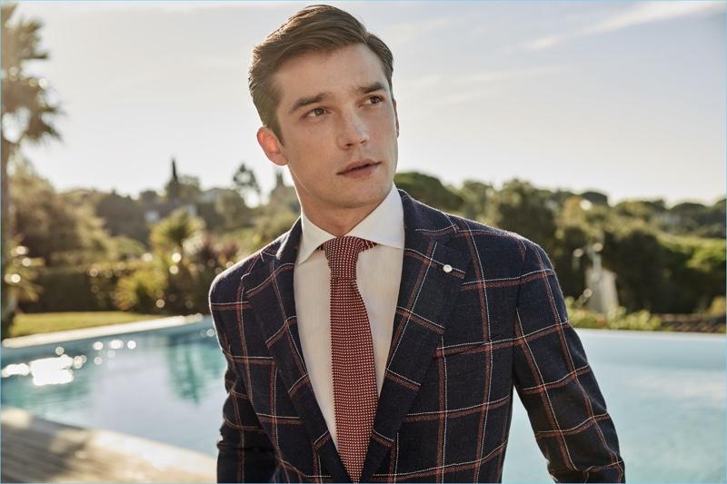 Alexis Petit dons a windowpane print blazer from Luigi Bianchi Mantova's spring-summer 2017 collection.