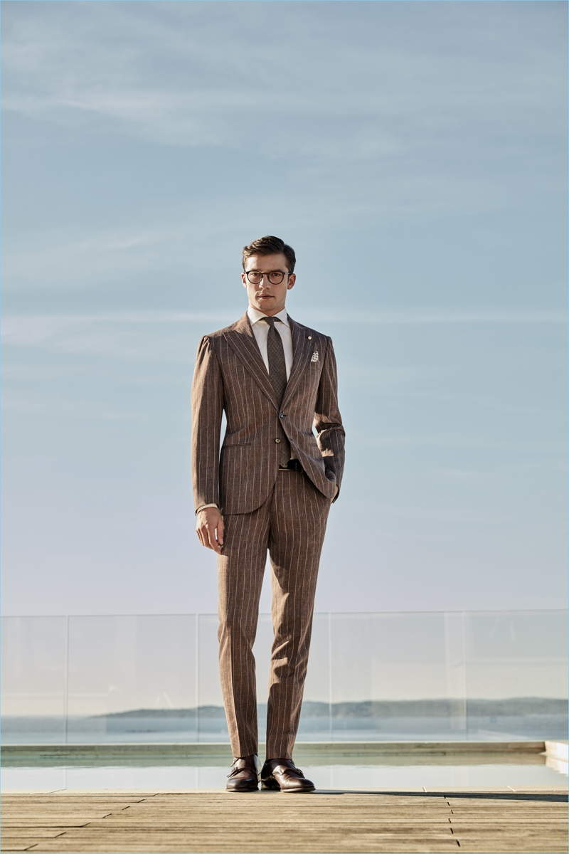 Standing tall, Alexis Petit wears a pinstripe suit from Luigi Bianchi Mantova's spring-summer 2017 collection.