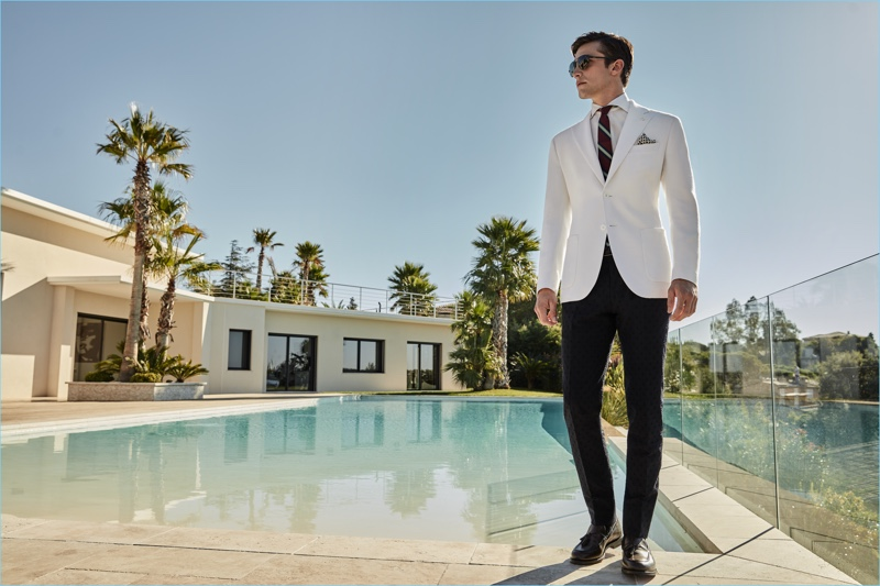 Wearing a crisp white and black number, Alexis Petit dons smart suiting separates by Luigi Bianchi Mantova.