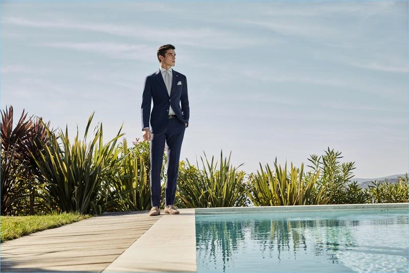 Model Alexis Petit sports a check blue suit from Luigi Bianchi Mantova.