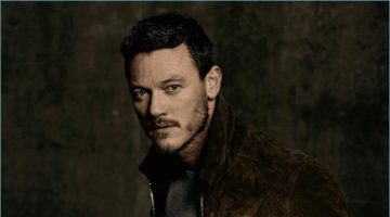 Luke Evans wears a t-shirt and suede jacket by AMI with Citizens of Humanity jeans.
