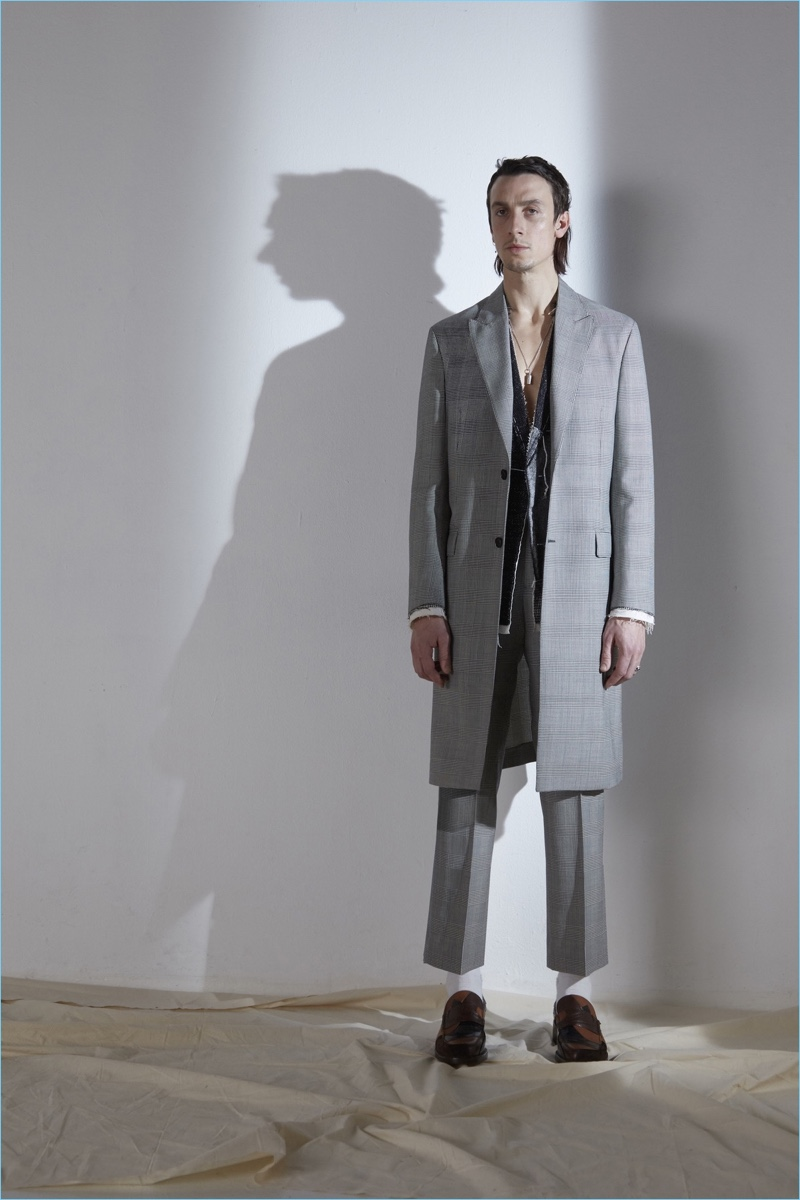 French fashion house Maison Margiela lets out the silhouette of narrow tailoring for fall-winter 2017.
