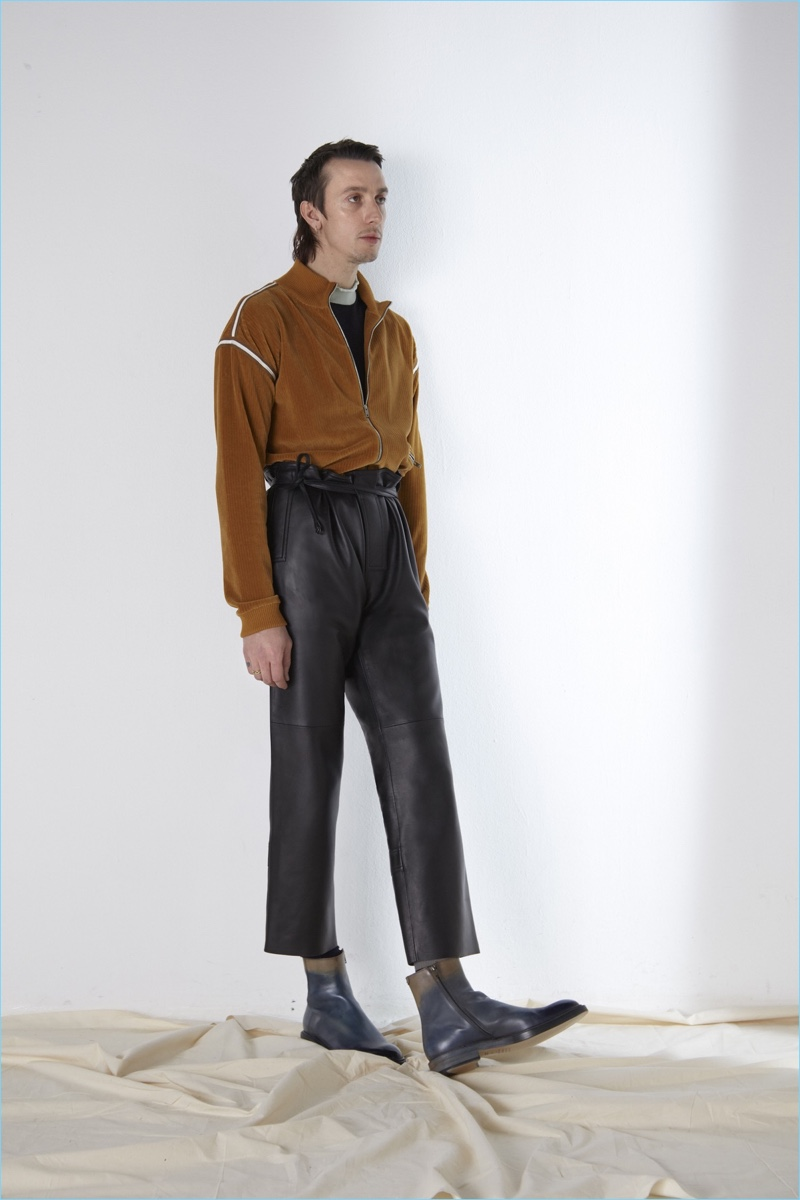 Revisiting leather pants, Maison Margiela turns out a cropped version with a paper bag waist.