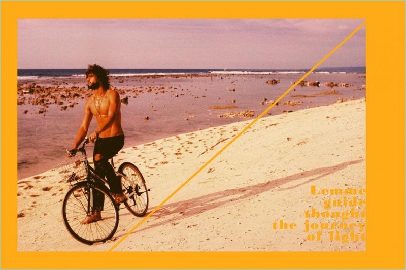 Marlon Teixeira takes to the beach for a bike ride.