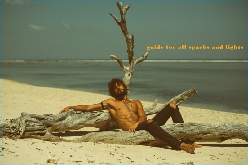 Going shirtless in ripped jeans, Marlon Teixeira is pictured on the beach.