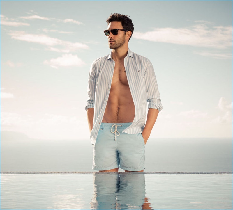 A summer vision, Noah Mills flashes his six-pack as he stars in Pedro del Hierro's spring-summer 2017 campaign.