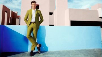 Making a statement in green, Eddie Klint dons a suit from Pal Zileri.