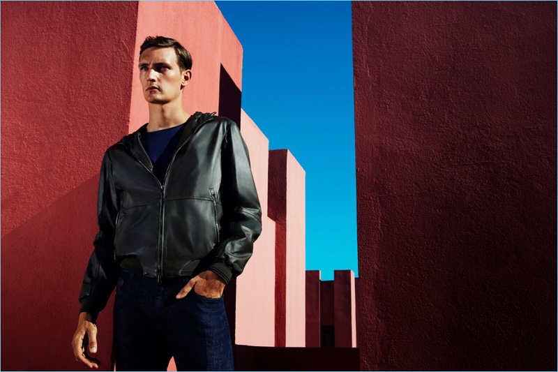 Model Yannick Abrath sports a hooded leather jacket from Pal Zileri.