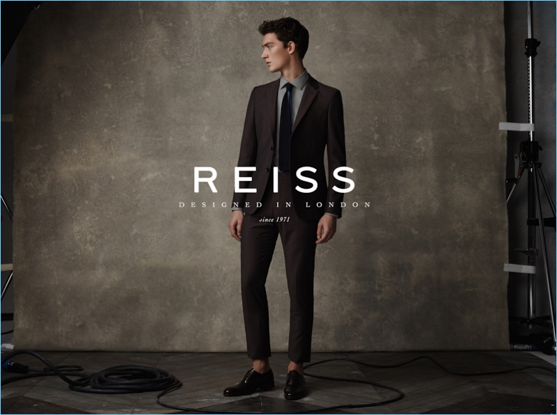 Cutting a sartorial figure, Otto Lotz wears suiting from Reiss for the brand's spring-summer 2017 campaign.