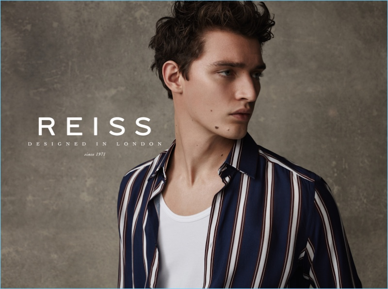 Model Otto Lotz dons a striped shirt for Reiss' spring-summer 2017 campaign.
