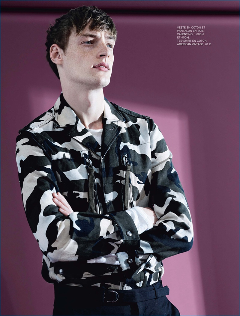 Model Roberto Sipos rocks a camouflage jacket with trousers by Valentino.
