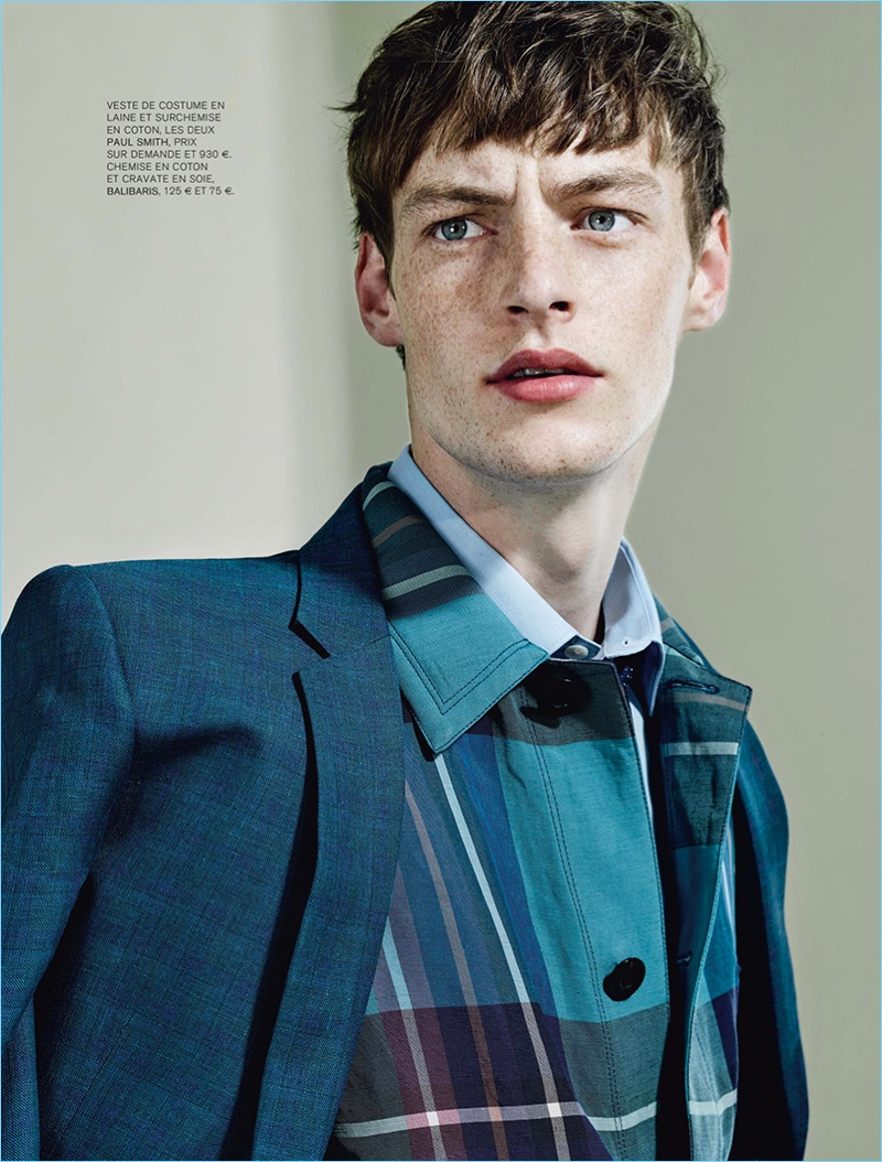 Taking to the studio, Roberto Sipos wears a blazer and check jacket from Paul Smith.