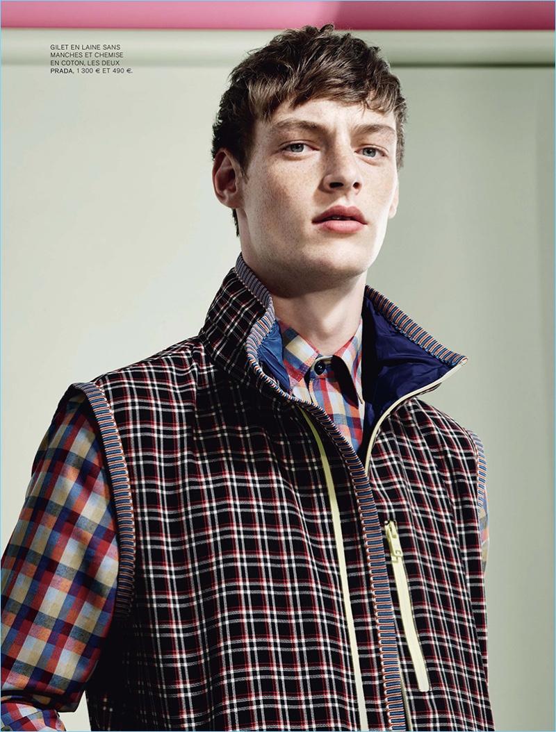 Mixing prints, Roberto Sipos wears preppy spring pieces from Prada.