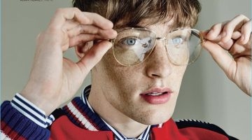 Wearing Gucci, Roberto Sipos adjusts his oversized glasses.