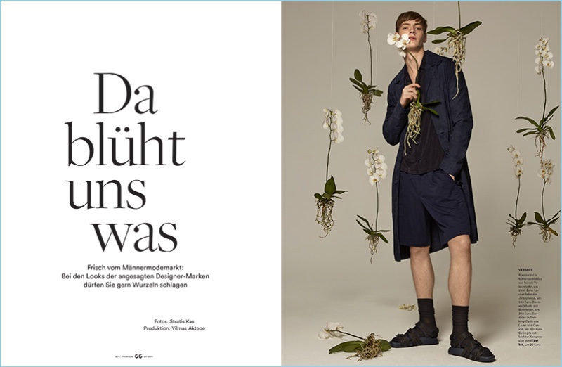 Sporty navy and black, Roberto Sipos wears a spring look by Versace.