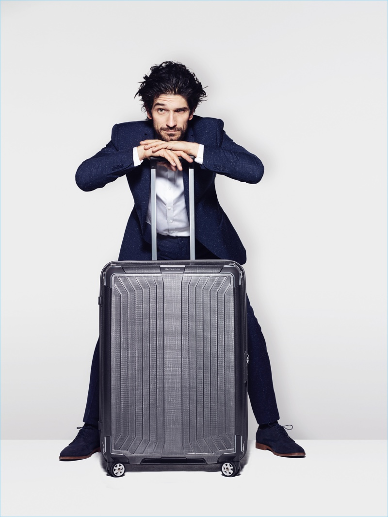 Jonathan poses with Samsonite's spinner luggage.