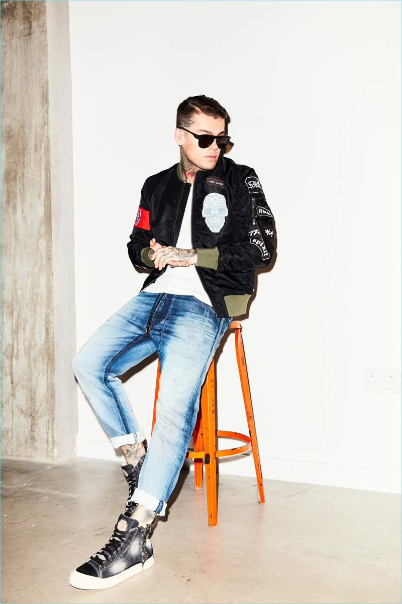 Stephen James goes casual in a Tigha bomber jacket and t-shirt with Diesel jeans.