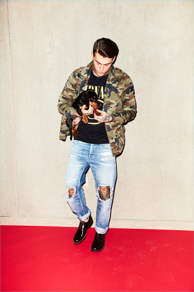 Making a camouflage statement, Stephen James wears a Replay jacket and jeans with a Jack & Jones Nirvana t-shirt.