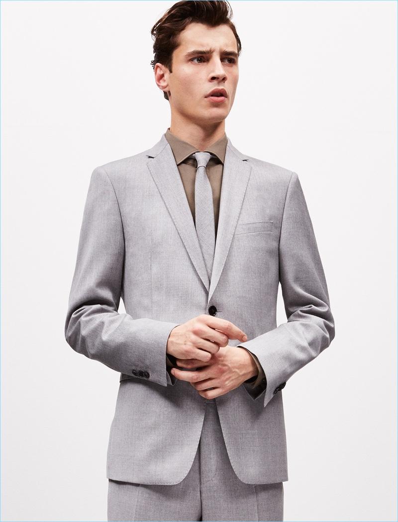 A sleek vision, Adrien Sahores dons grey suiting for Strellson's spring-summer 2017 lookbook.