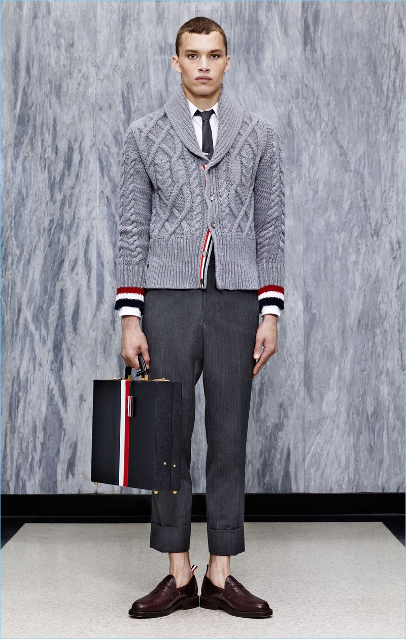 The shawl cable-knit sweater is front and center with cropped trousers from Thom Browne's spring-summer 2017 collection.