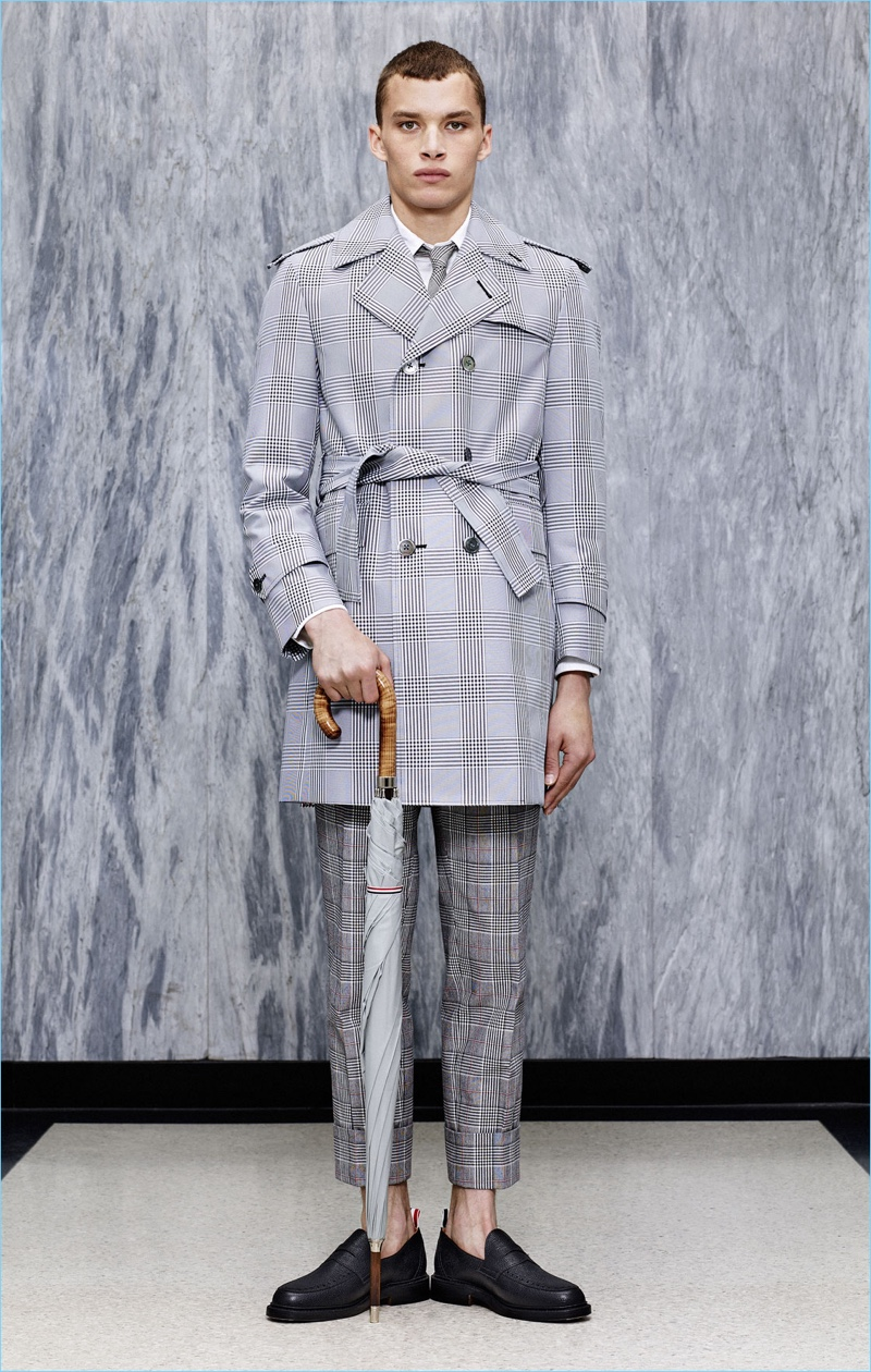 Louis Mayhew dons a trench coat and cropped trousers from Thom Browne's spring-summer 2017 collection.