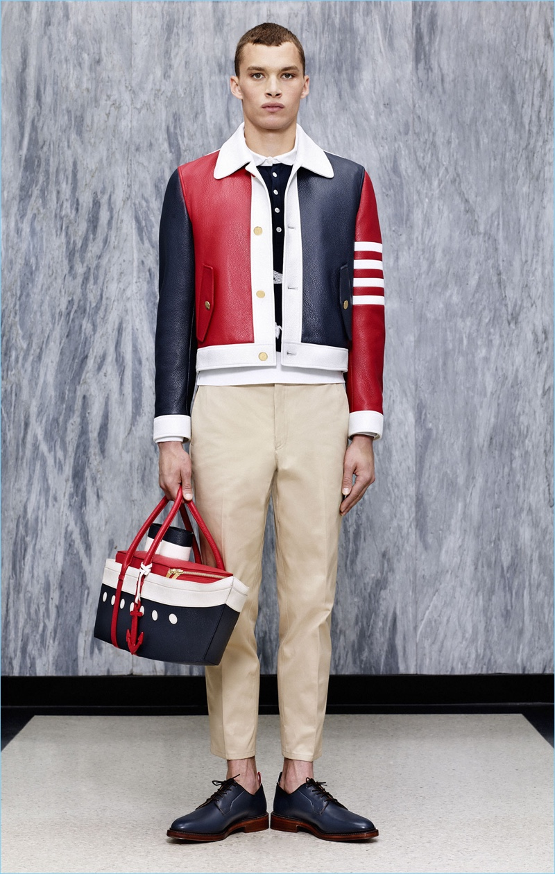 Thom Browne's signature red, blue, and white motif come together for a statement blouson jacket.