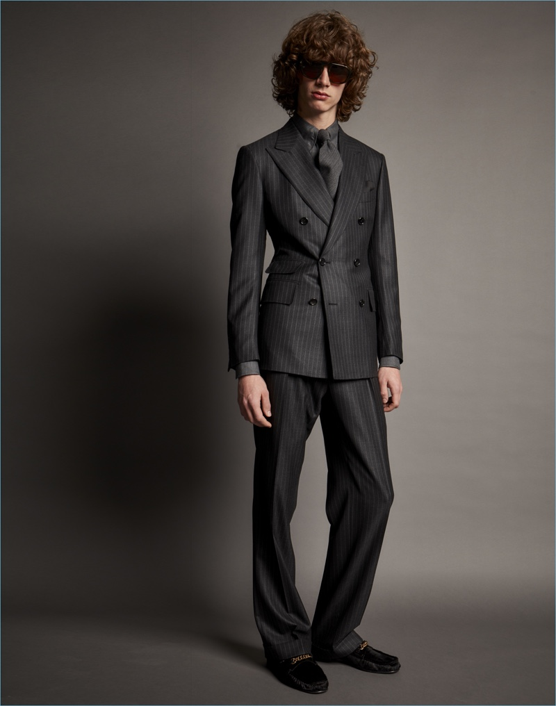Luxury label Tom Ford turns out a double-breasted pinstripe suit for fall-winter 2017.