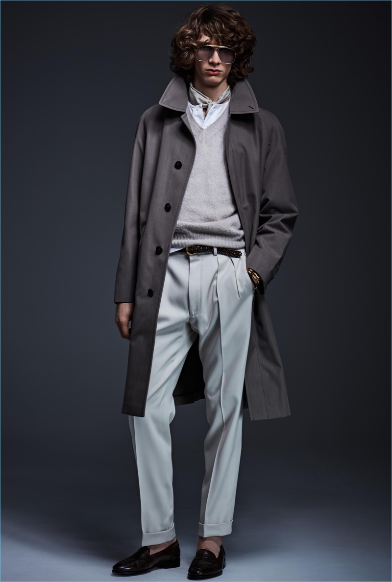 Model Erik van Gils is dashing in a coat and pleated trousers by Tom Ford.