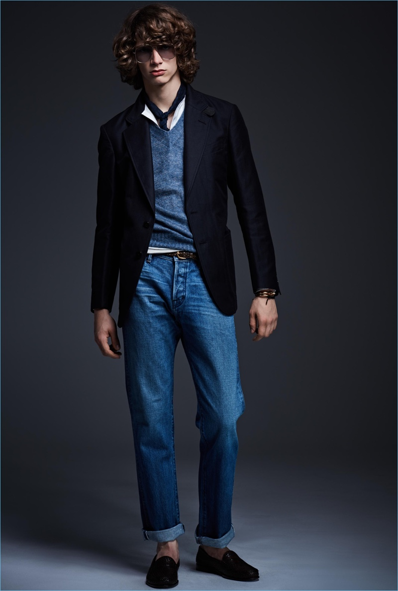Going casual, Erik van Gils wears denim jeans with a sport coat and v-neck sweater from Tom Ford.