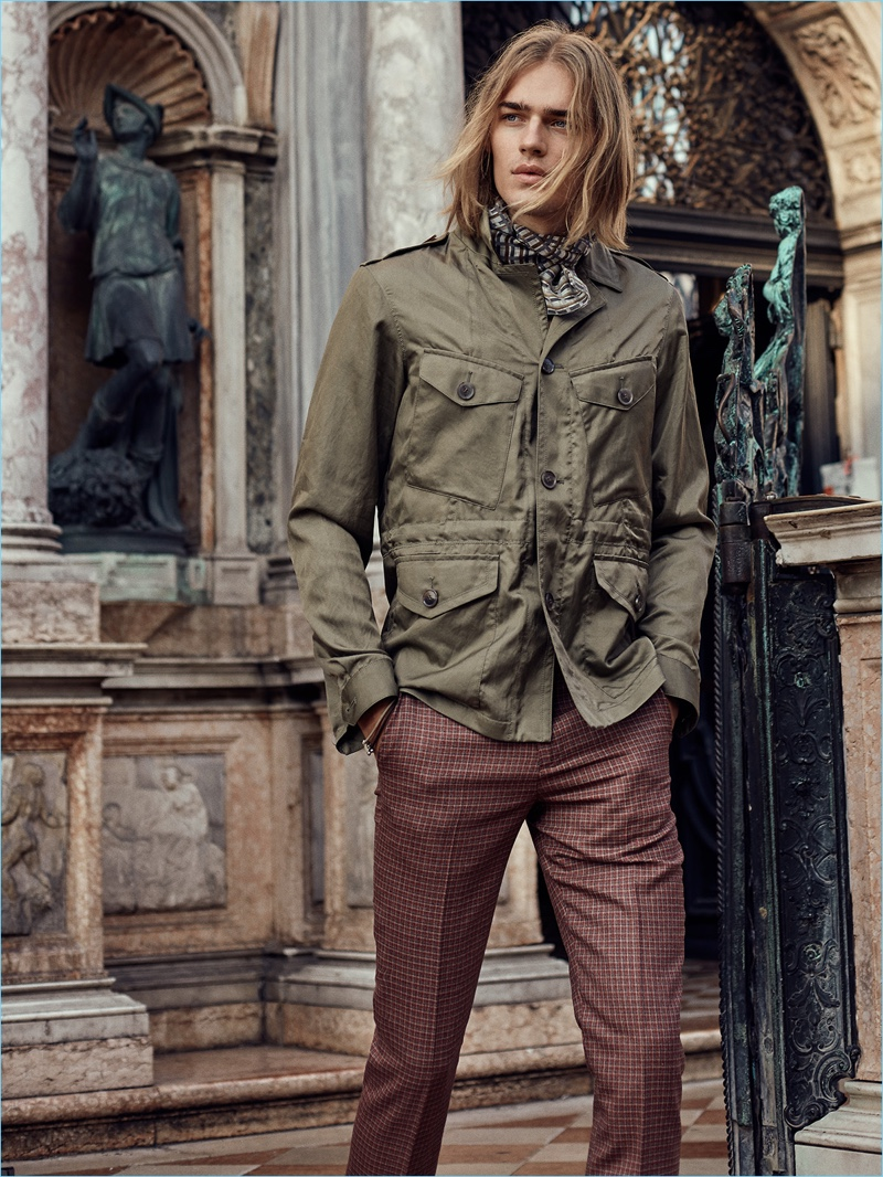 Starring in an editorial for August Man Malaysia, Ton Heukels wears a field jacket and check trousers by Paul Smith. Ton also sports an Ermenegildo Zegna scarf.