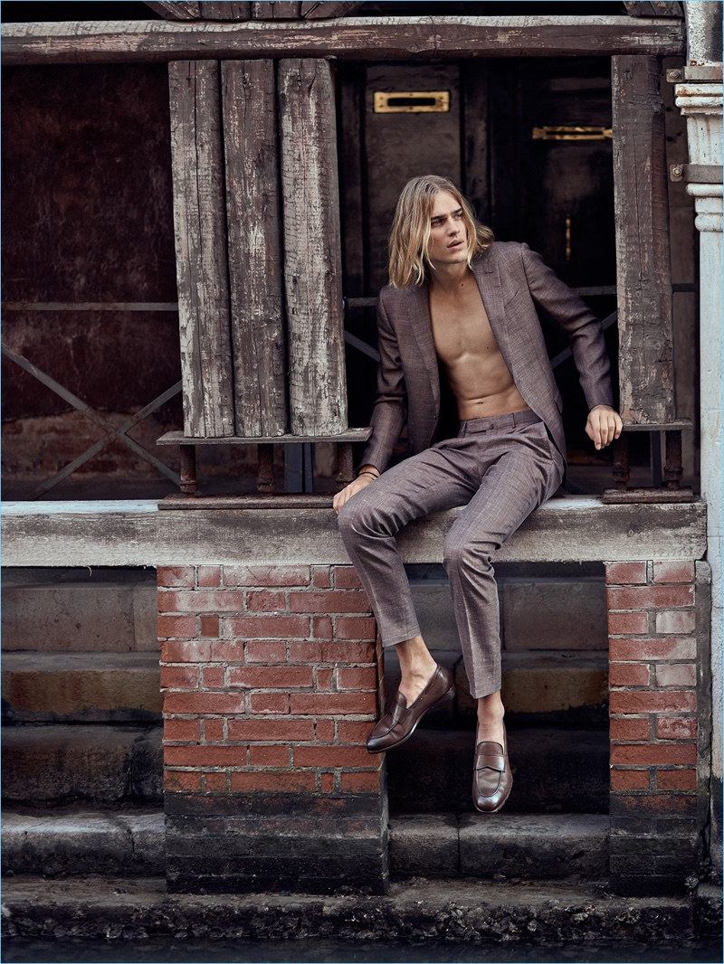 Greg Swales photographs Ton Heukels in a suit and shoes by Ermenegildo Zegna.