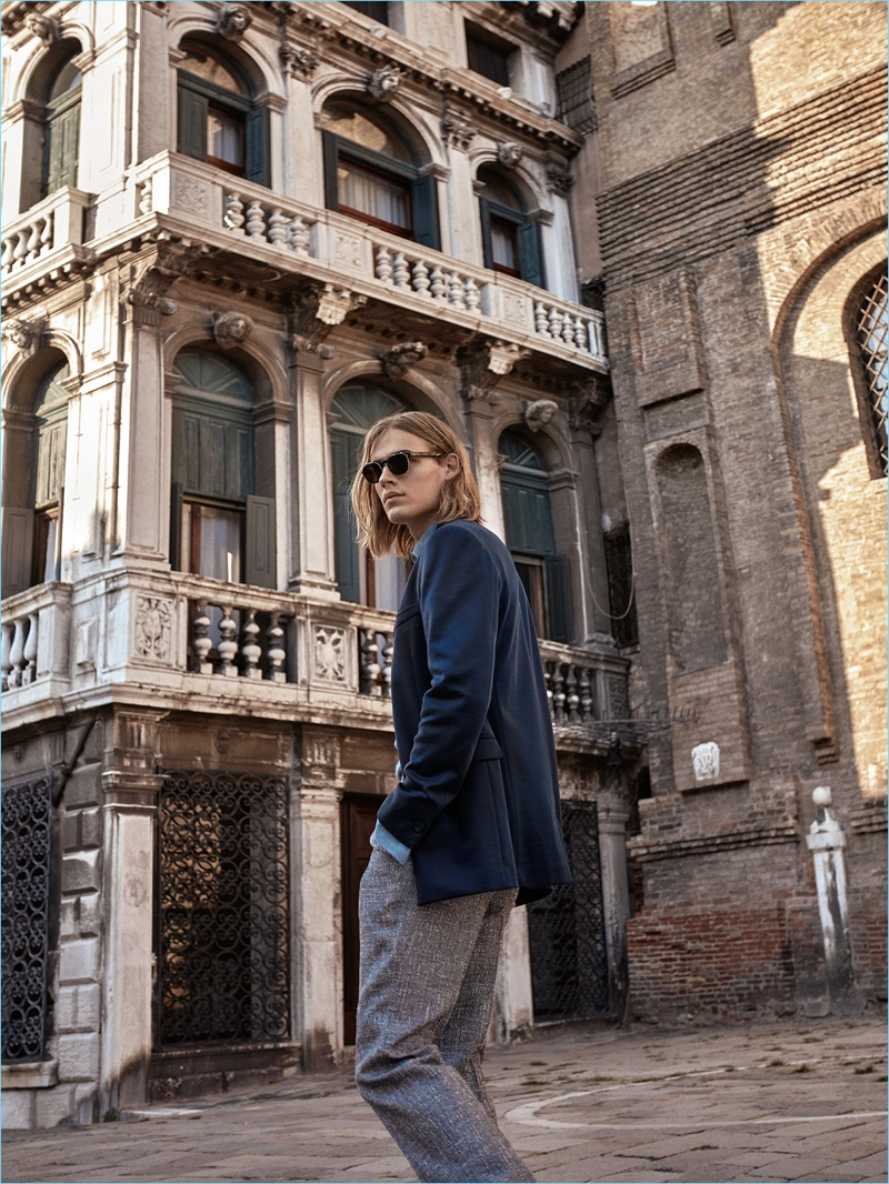 Model Ton Heukels wears a Versace jacket with a shirt and trousers by Canali.