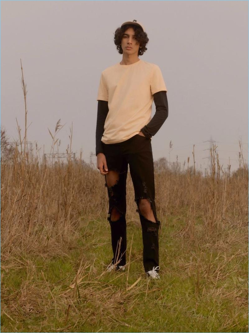 Model Callum Stoddart layers a long-sleeve tee with a short-sleeve t-shirt and extreme ripped skinny jeans from Topman.