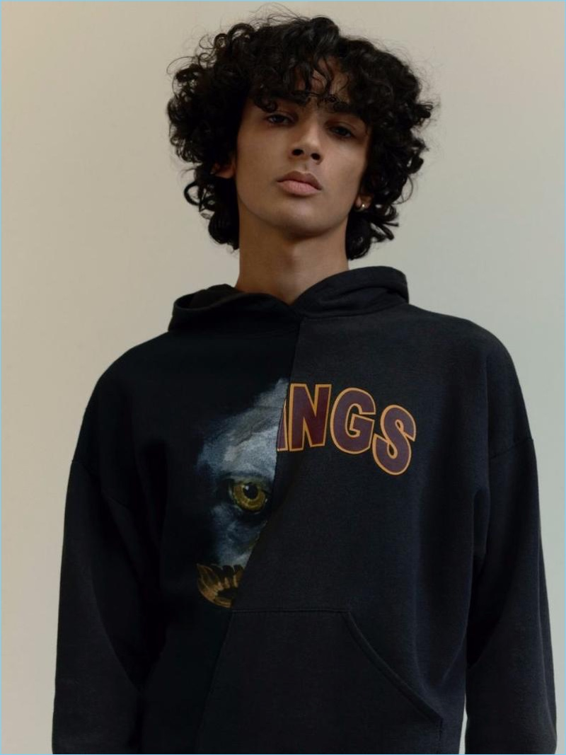 Sporting a black Eagle Kings print spliced hoodie, Callum Stoddart connects with Topman for spring.