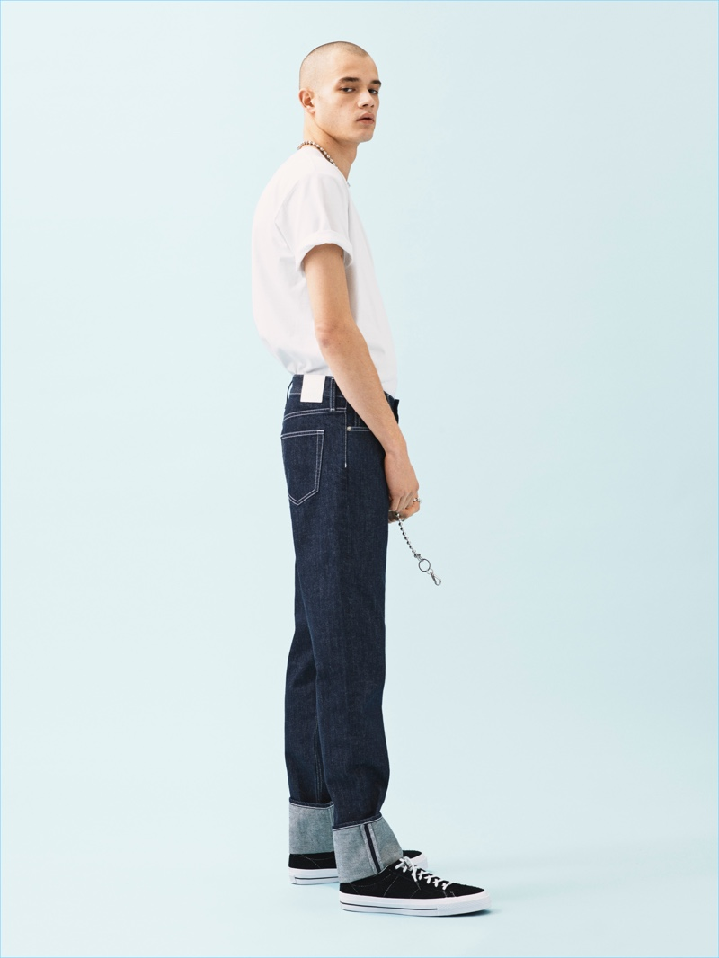 Going casual, Maxime Frenel wears a simple t-shirt with straight fit jeans for Weekday's spring-summer 2017 campaign.