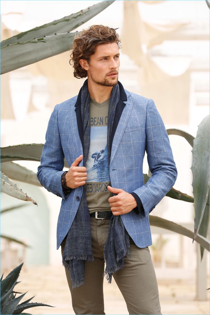 Scapa tackles an elegant spin on casual style, pairing a graphic tee with a windowpane print blazer.