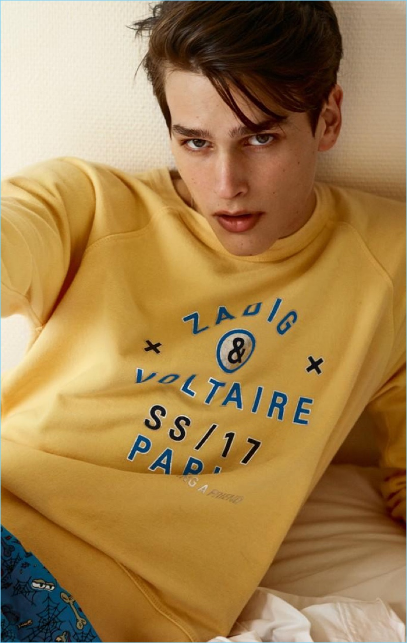Going casual, Simon van Meervenne wears a yellow Zadig & Voltaire sweatshirt.