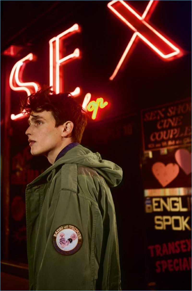 Stepping out, Simon van Meervenne sports a green parka from Zadig & Voltaire.