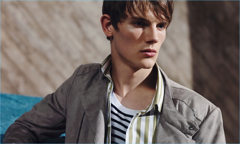 Callum Ward layers Zara fashions with a striped shirt and t-shirt.