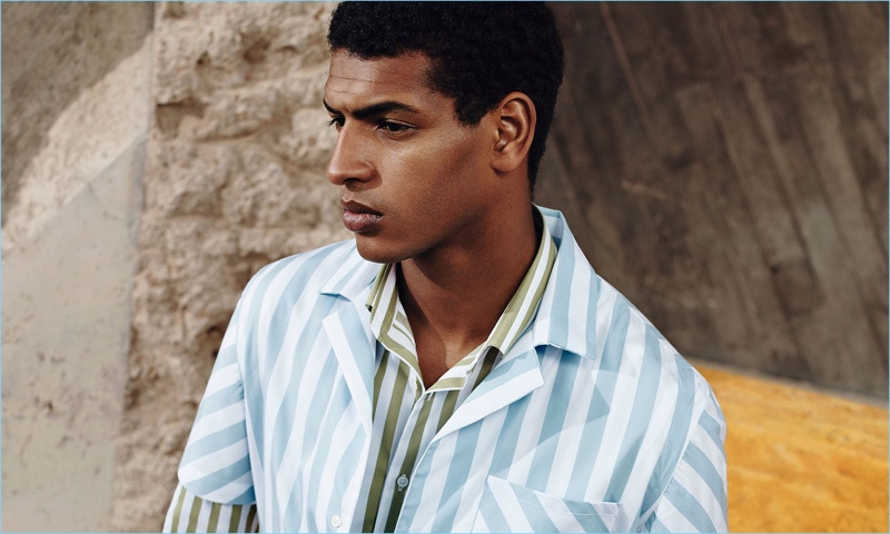 Tidiou M'Baye embraces spring pastels with striped shirts from Zara Man.