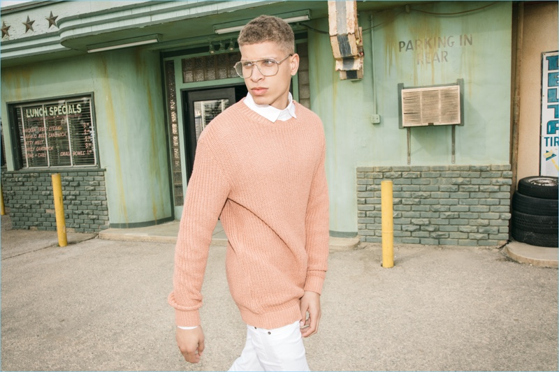 Wearing glasses, Chuck Achike sports an oversized ribbed sweater for boohooMAN's spring 2017 campaign.