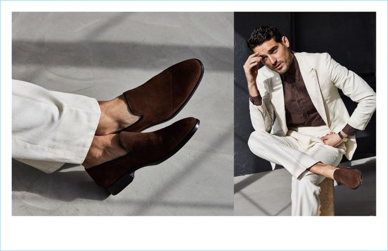 A sleek vision in a white suit, Arthur Kulkov models Between Rivers' slip-on in chocolate suede.